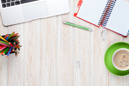 Foto de Office desk table with computer, supplies and coffee cup. Top view with copy space - Imagen libre de derechos