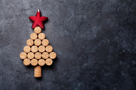 Photo pour Wine corks shaped christmas tree on stone table. Top view with copy space for your text - image libre de droit