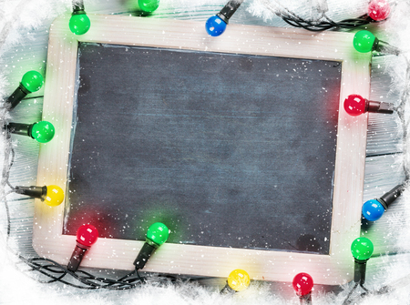 Photo pour Christmas chalkboard and lights. Top view with copy space for text - image libre de droit