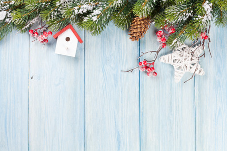 Photo pour Christmas wooden background with snow fir tree and decor. View with copy space - image libre de droit