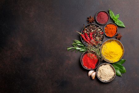 Various spices and herbs on stone table. Top view with space for your text