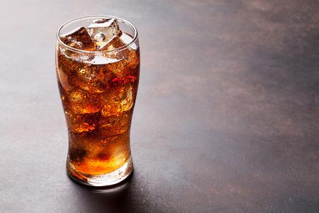Photo pour Cola glass with ice cubes with copy space - image libre de droit