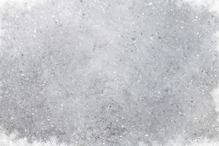 Christmas stone background with snow. Xmas backdrop for greeting card with space for your greetings