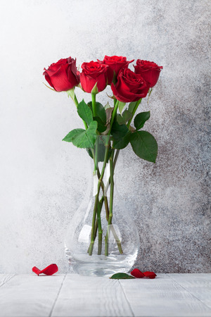 Photo for Red rose flowers bouquet in front of stone wall - Royalty Free Image