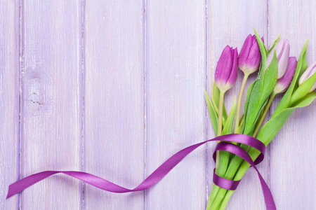 Foto für Purple tulips on wooden table. Top view with space for your text - Lizenzfreies Bild