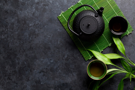 Photo for Green japanese tea on stone table. Top view with copy space - Royalty Free Image