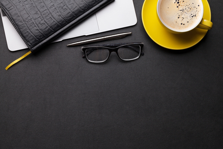 Photo pour Office workplace table with coffee cup, supplies and computer. Flat lay. Top view with space for your goals - image libre de droit