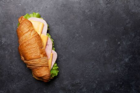 Photo pour Croissant sandwich on stone table. French breakfast. Top view flat lay with copy space for your text - image libre de droit
