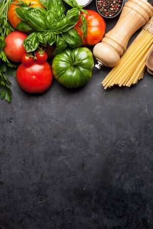 Photo for Pasta, tomatoes and herbs. Cooking ingredients on stone table. Top view with copy space. Flat lay - Royalty Free Image