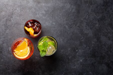 Photo pour Three classic cocktail glasses on stone table. - image libre de droit