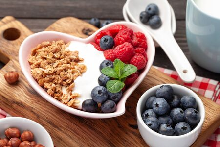 Photo for Healthy breakfast with homemade granola with yogurt and fresh berries - Royalty Free Image