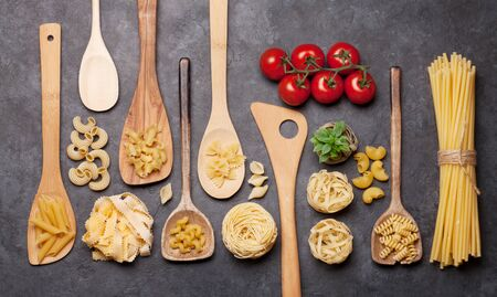 Photo for Various pasta in spoons. Top view flat lay - Royalty Free Image