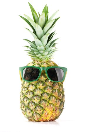 Photo pour Ripe pineapple with sunglasses isolated on white background. Travel and vacation concept - image libre de droit
