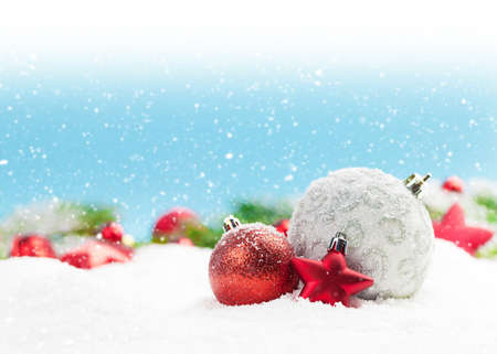 Photo pour Christmas greeting card with decor in snow over blurred bokeh background and copy space for your xmas greetings - image libre de droit