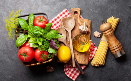 Photo for Italian cuisine ingredients. Garden tomatoes, pasta, herbs and spices. Top view - Royalty Free Image