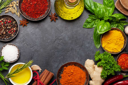 Photo for Various spices, herbs and condiments on dark stone table. Indian cuisine. Top view flat lay with copy space - Royalty Free Image
