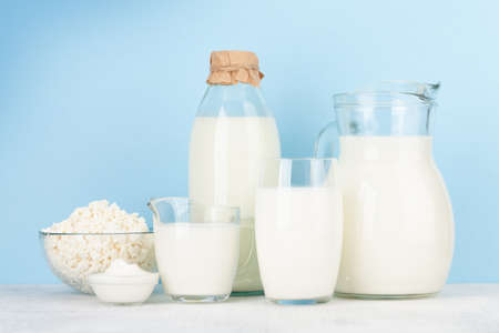 Photo for Various dairy products. Milk, cheese, cottage, sour cream. In front of blue background - Royalty Free Image