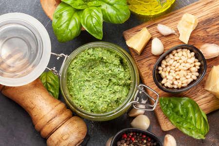 Foto für Homemade pesto sauce with basil leaves, pine nuts, parmesan and garlic. Top view flat lay - Lizenzfreies Bild