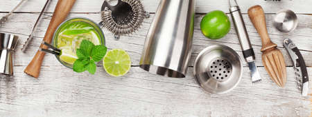 Photo pour Cocktail utensils. Set of bar tools and mojito cocktail on wooden table. Top view flat lay - image libre de droit