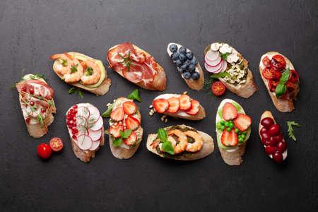 Photo pour Appetizers plate with traditional spanish tapas set. Italian antipasti brushetta snacks. Top view flat lay - image libre de droit