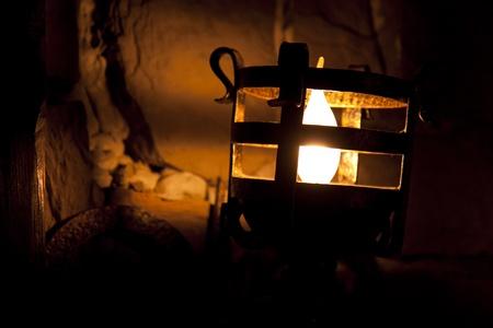Old lamp shining on the dark room around
