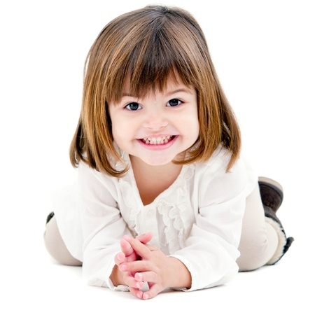 Portrait of cute little girl with toothy smile. Isolated on white background.