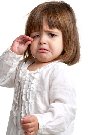 Photo pour Portrait of litte girl crying. Isolated on white background. - image libre de droit
