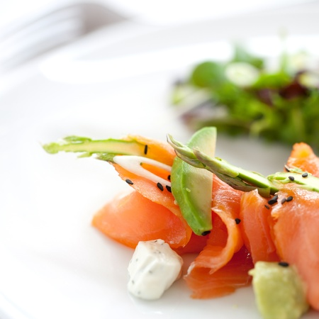 Close up of smoked salmon salad with green asparagus and avocado