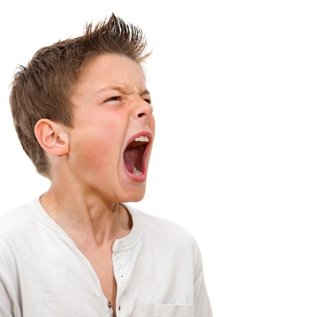 Photo pour Close up portrait of angry boy shouting  Isolated on white background - image libre de droit