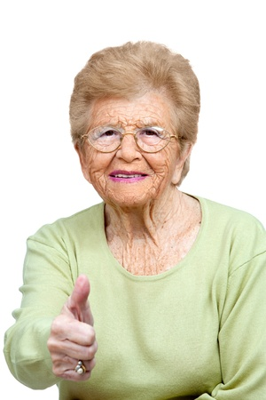 Close up portrait of friendly senior woman showing thumbs up Isolated on white