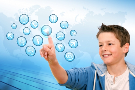 Portrait of Boy pointing at web icons with futuristic interface