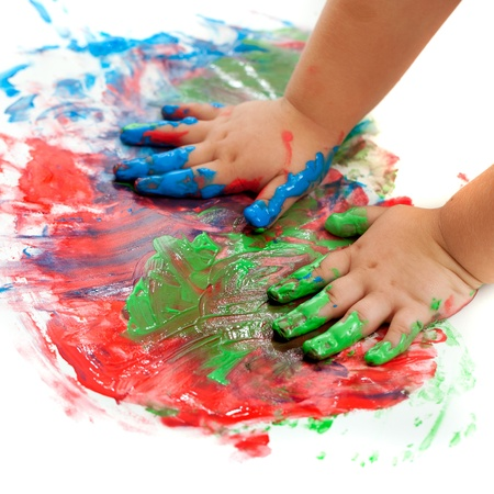 Photo for Close up of baby hands painting mosaic. - Royalty Free Image