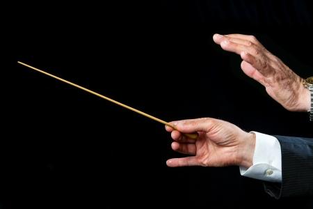 Photo pour Close up of male conductors hands ready to direct. - image libre de droit