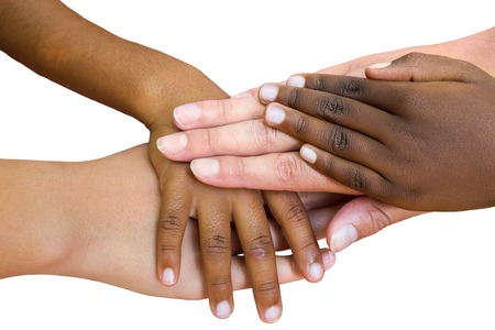 Photo pour Macro close up of multiracial child hands joined together. Isolated on white background. - image libre de droit