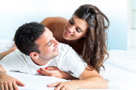 Photo pour Portrait of handsome Young couple sharing intimacy in bedroom. - image libre de droit