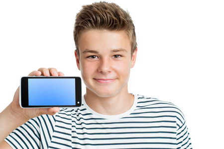Close up portrait of Handsome teen showing smart phone with blank screen.Isolated on white background.