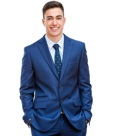 Close up portrait of attractive young businessman in blue suit. Half body portrait Isolated on white background.