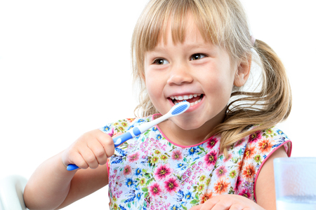 Photo pour Close up portrait of cute five year old brushing teeth.Isolated on white background. - image libre de droit