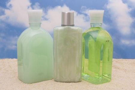Bottles of moisturizers on beach