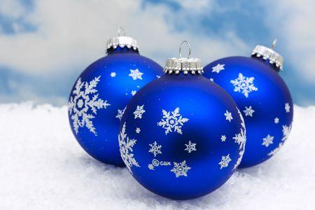 Blue Christmas balls on snow