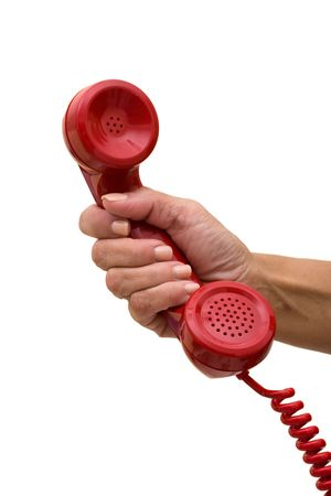 Photo pour A hand holding a red handset of a telephone isolated on a white background, answering the telephone - image libre de droit