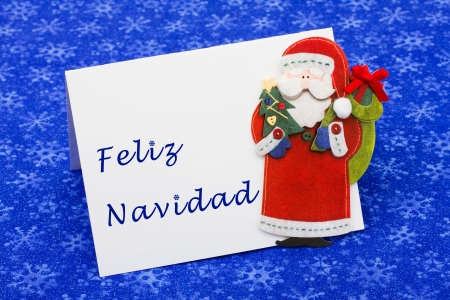 An envelope saying feliz navidad with a Santa Claus on a blue snowflake background, Christmas letter