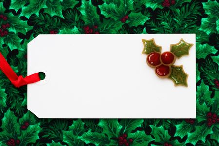A blank gift tag sitting on a wrapped present, Christmas present