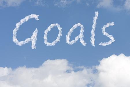 The word goals written in the blue sky, Reaching your dreams