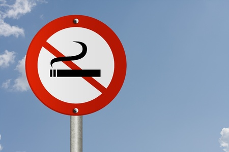 An American road sign and no smoking symbol with sky background and copy space for your message, Stop Smoking Sign