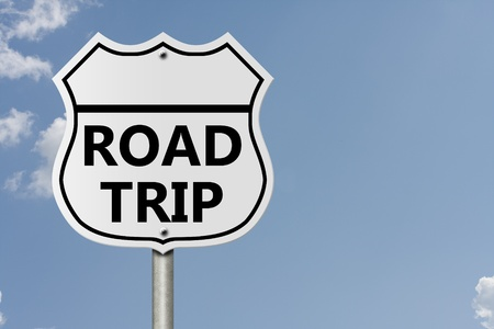 An American interstate road sign with words Road Trip with sky background, Taking a Road Trip