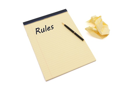 Blank yellow lined notepad with copy-space, a pen, and crumpled paper, Defining your rules