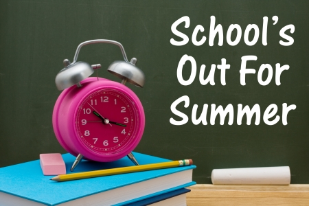 Book with pencil and eraser with a retro alarm clock  in front of a chalkboard, Schools out of Summer