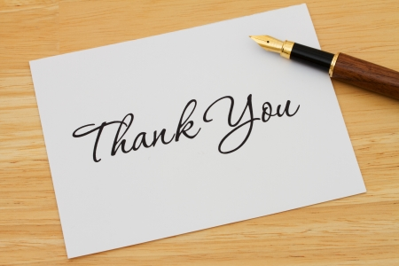 A thank you card with a fountain pen on a wooden desk, Writing a Thank You Note