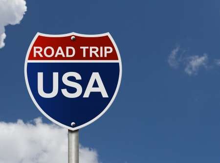 An American road interstate sign with words Road Trip USA with sky, Road Trip USA